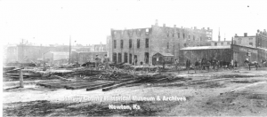 Murphy Studio Photograph looking west to the back of the Main Street Buildings after clean up had begun, August 1914