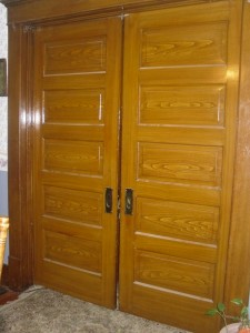Pocket doors with false graining.