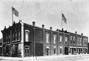 Masonic Building, 700 N. Main, Newton, c. 1897.  Postcard, with large flags added.  This building housed the Harvey County Counthouse in 1880-1888 and again in 1896-1906.