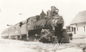 Missouri Pacific Passenger Train No. 742 crossing east 4th St., Newton, summer 1920.  Photo by Lawrence E. Hauck.