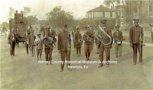 """""""Rickman's Band"""" Booster Day Parade, 1910, standing in formation at Main and 8th Street, Newton"""