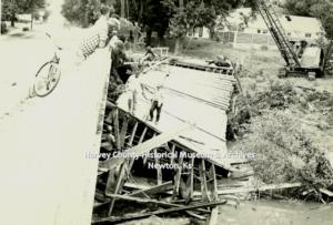 Ash Street Bridge debris against the W. Broadway Bridge, Newton, Ks June 1965.