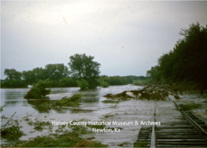Flood water covering ther Missouri Pacific Railroad tracks south of D.V. Preeim farm at 1900 N. Main, Newton, Ks, June 1965.