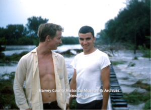 G. Standish and W. Bradshaw taking a break. In the background are the Missouri Pacific Railroad tracks. June 1965.