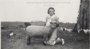 Carmen Gillmore, Walton Club with her blue ribbon ;Shropshire ewe, 1934.