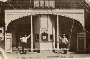 Ticket booth at the Star Theatre, 506 Main, Newton, 1913. Ed Wagner is on the left. HCHM Photo Archives.